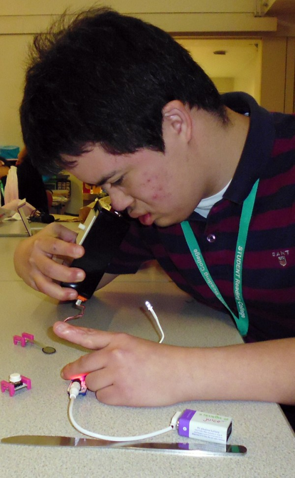 Guillermo using littleBits to trigger a smellbox developed by sensory objects, the box contained lavender blown by a fan triggered by littleBits